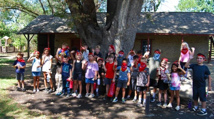 Camp Adobe Campers waving good by to Peña Adobe.  See you next year!