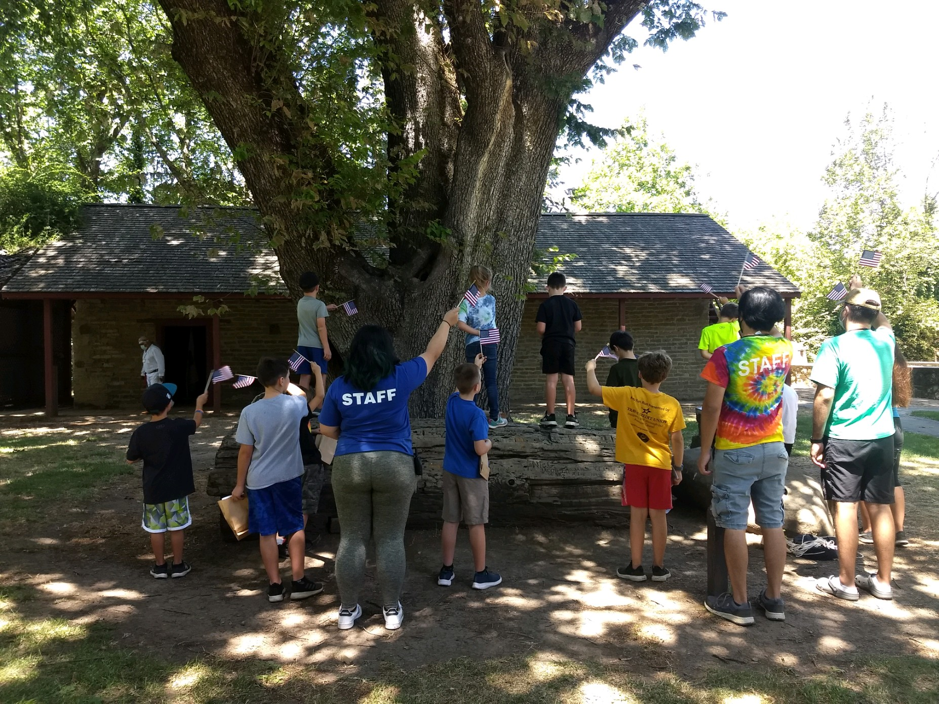Camp Adobe Campers waiving good by to Peña Adobe.  See you next year!